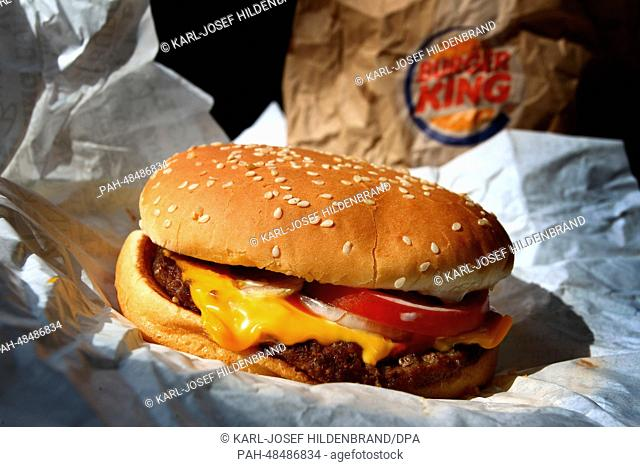 A Whopper from the fast food chain Burger King sits on a packaging paper in Kaufbeuren, Germany, 05 May 2014. Photo: Karl-Josef Hildenbrand/dpa | usage...