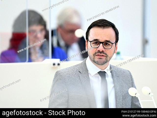27 January 2021, Brandenburg, Potsdam: Jan Redmann, CDU parliamentary party leader, speaks during the state parliament session in the topical hour requested by...