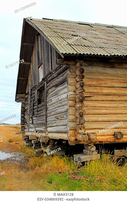 Old fisherman's shed in North of Russia. Pomors chopped house. White sea