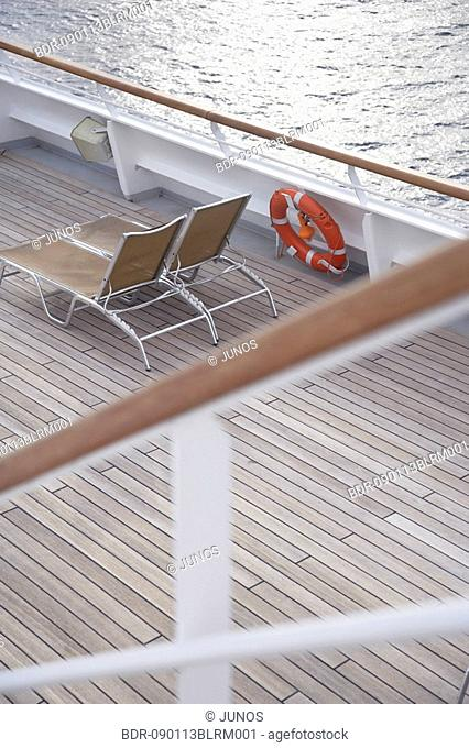 view at sun loungers on deck of cruise ship