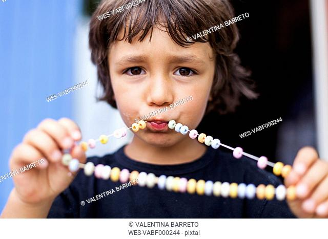 Portrait of little boy with necklace of Hundreds and Thousands