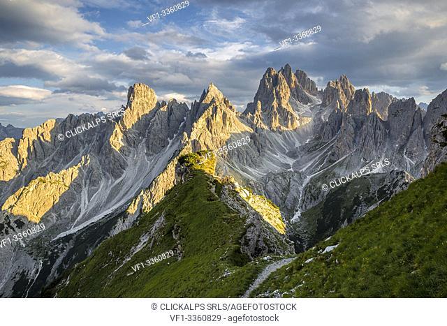 Italy, Veneto, Belluno district, Auronzo di Cadore, sunset over the many spiers that shape the Cadini di Misurina group