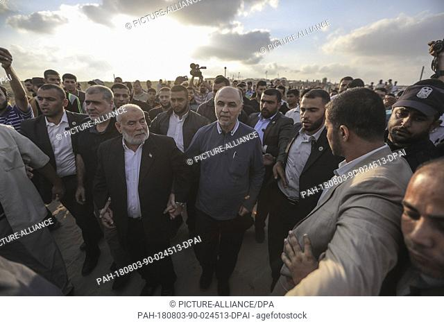 Maher Salah (C), prominent leader in the Hamas Palestinian Islamist movement and head of Hamas abroad, takes part in a protest along the Israel-Gaza border