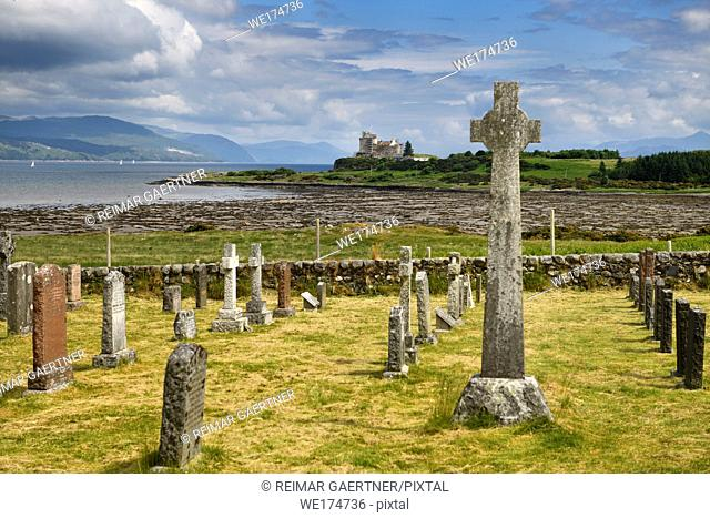 Ancient tombstones and Celtic cross at Kilpatrick Cemetery next to Duart Castle on Isle of Mull on Sound of Mull Loch Linnhe Scotland UK
