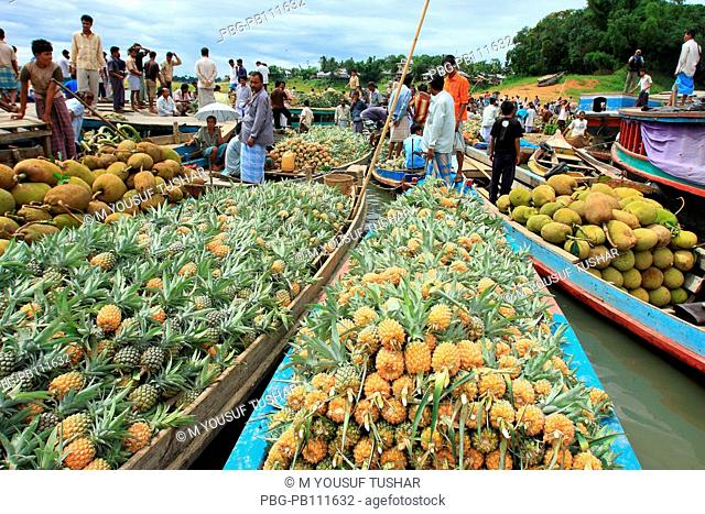 Floating wholesale fruits market in Rangamti, one of the hill districts of Bangladesh June 2008