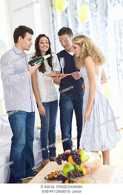 friends drinking champagne at party