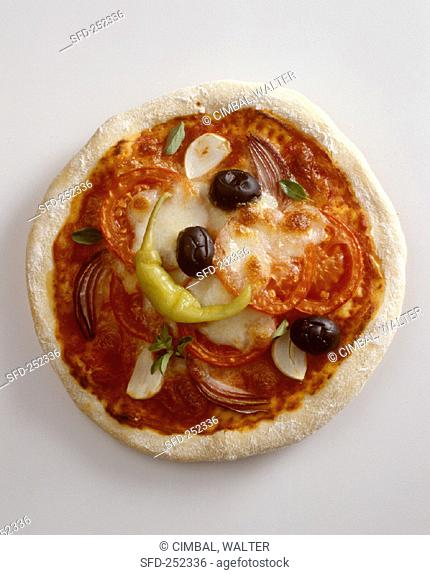A pizza with tomatoes, olives, pepperoni and mozzarella