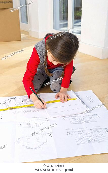 Germany, Bavaria, Grobenzell, Girl drawing house of blue print