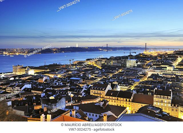 Lisbon, the historical centre, and the Tagus river at dusk. Portugal