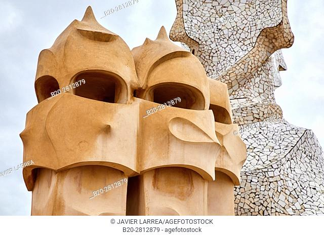 Chimneys on the rooftop of Casa Mila, La Pedrera building, Antoni Gaudi, Barcelona, Catalonia, Spain