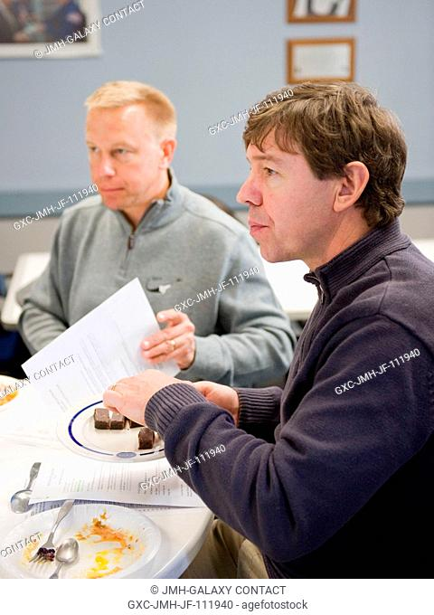 NASA astronauts Michael Barratt (right) and Tim Kopra, both STS-133 mission specialists, are pictured during a food tasting session in the Habitability and...