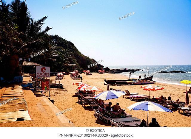 Tourists on the beach, Curlies Bar and Restaurant, Anjuna, North Goa, Goa, India
