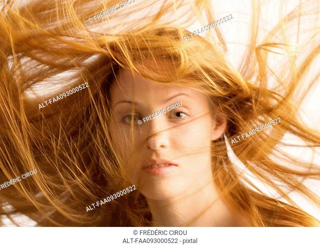 Woman, long hair being tousled