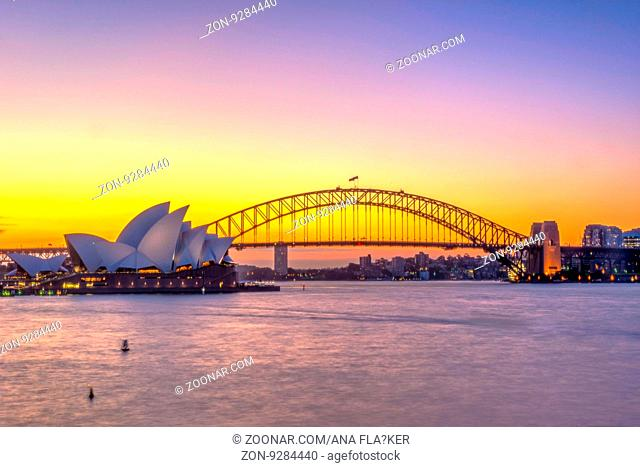 View on Sydney Opera house and harbour bridge at sunset