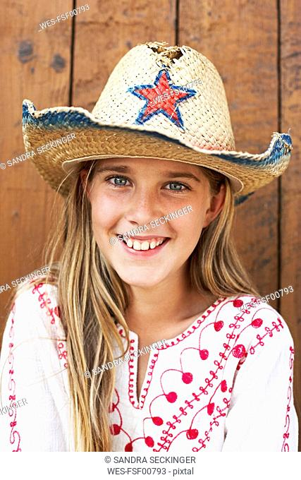 Portrait of smiling girl wearing straw hat