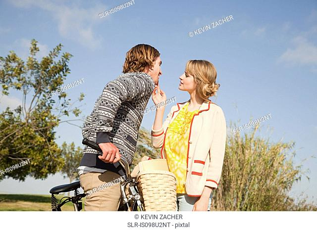 Young couple and bicycle
