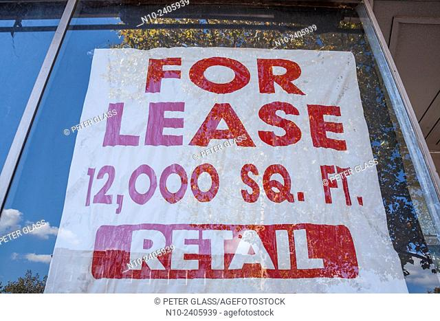 """Sign in an office building window reading, """"""""For Lease"""""""""""
