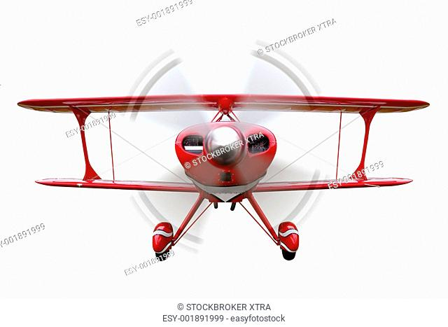A red biplane, front view with propeller in motion, isolated on a white background