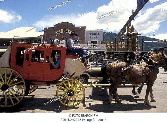 stage coach, Jackson, WY, Wyoming, A stage coach carries tourists through downtown Jackson