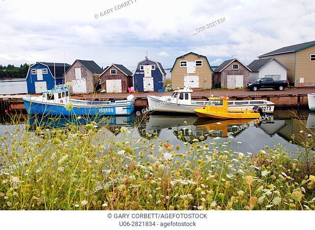 Fishing boats shacks and wharf at Stanley Bridge Prince Edward Island Canada
