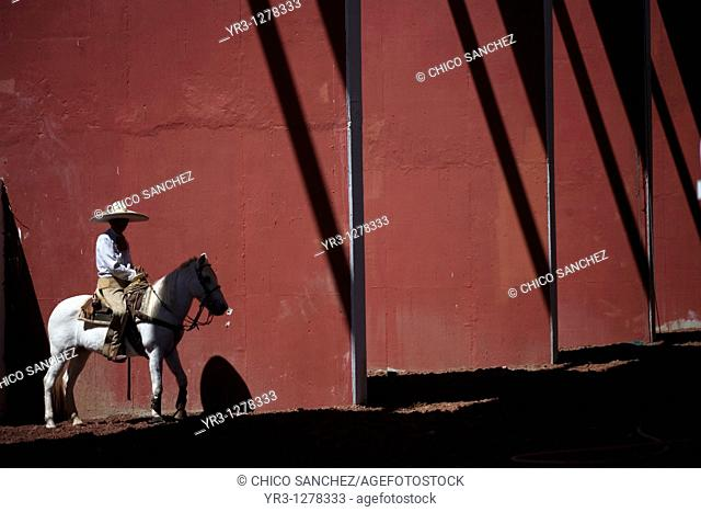 A Mexican charro ride his horse at the National Charro Championship in Pachuca, Hidalgo State, Mexico. Escaramuzas are similar to US rodeos