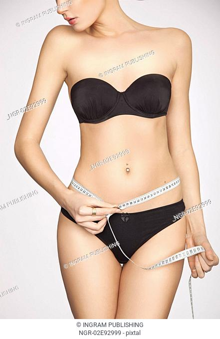 woman measuring perfect shape of beautiful thigh healthy lifestyles concept