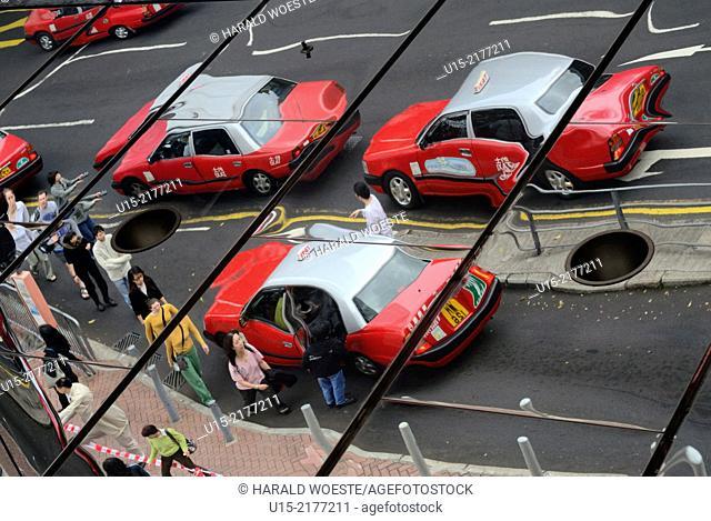Hong Kong, China, Asia. Mirror image of typical Hong Kong Taxis
