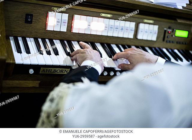 Priest plays church organ