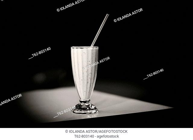 Strawberry milkshake on table, black and white still life