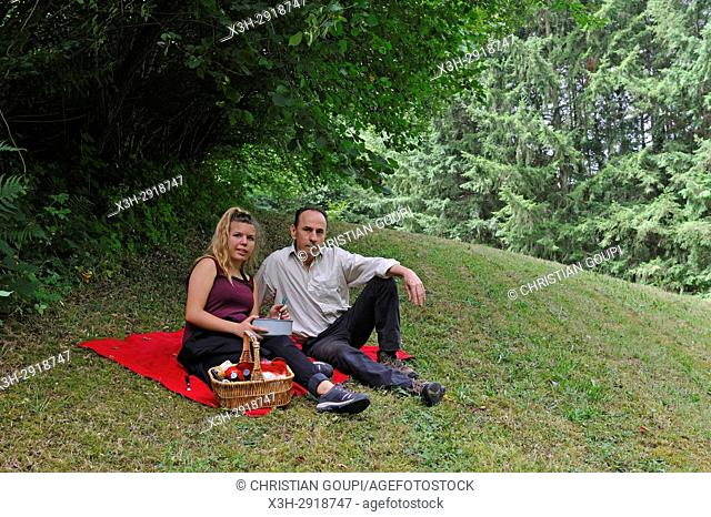 father and daughter having pic-nic in a meadow, Puy-de-Dome department, Auvergne-Rhone-Alpes region, France, Europe