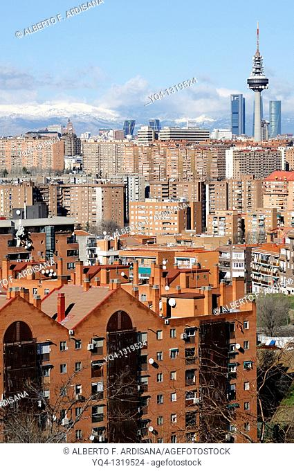Views from Madrid, with the Four Towers, telecommunications tower ', Pirulí', Kio Towers in the background and the Sierra of Madrid snowed