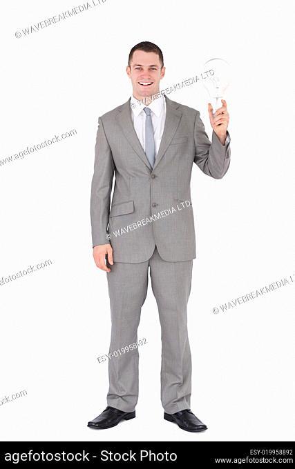 Portrait of a businessman holding a bulb