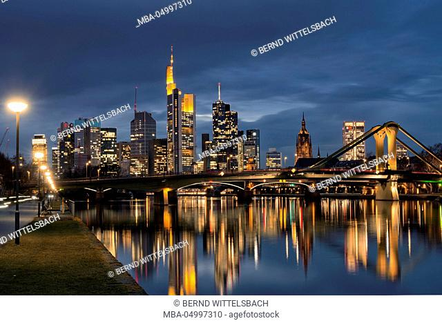 View from the riverside promenade on the Frankfurt skyline at dusk, Frankfurt am Main, Hesse, Germany