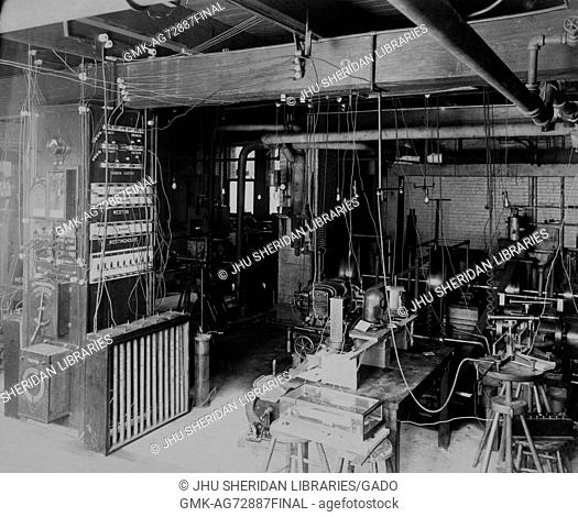 Interior of dynamo room in Johns Hopkins University old campus physics building, 1890