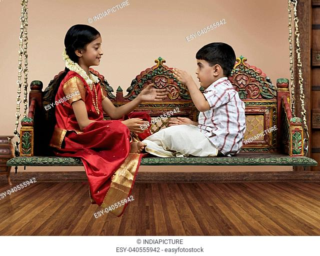 South Indian girl playing with her brother
