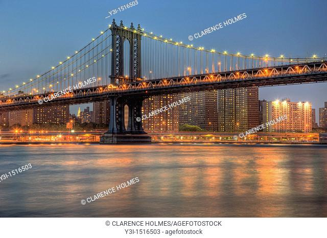 View under the Manhattan Bridge of the East River and lower Manhattan, as seen from Brooklyn Bridge Park, New York City, USA
