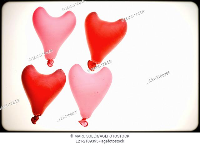 Group of four heart red shaped balloons