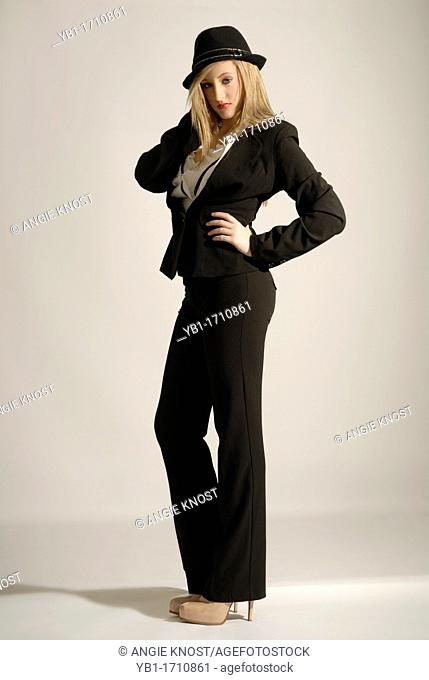 Attractive blonde woman wearing classic pantsuit