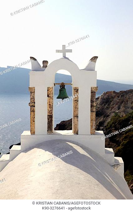 Belltower of a church in Oia with view into the caldera, Santorin, Greece, Europe