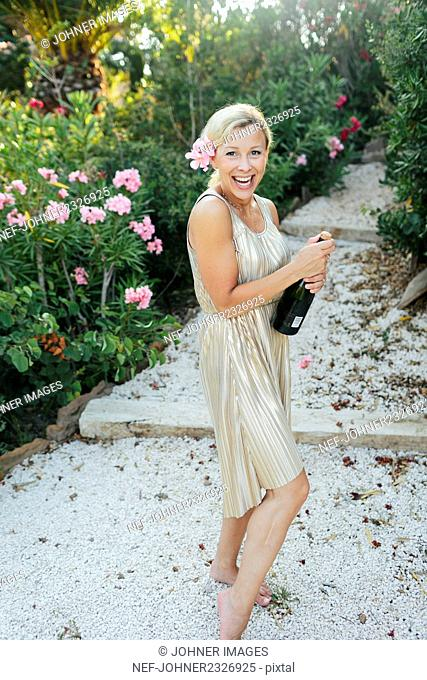 Happy woman with champagne bottle