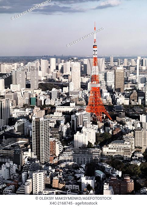 Bright red Tokyo Tower in city landscape aerial view, artistic photo. Tokyo, Japan