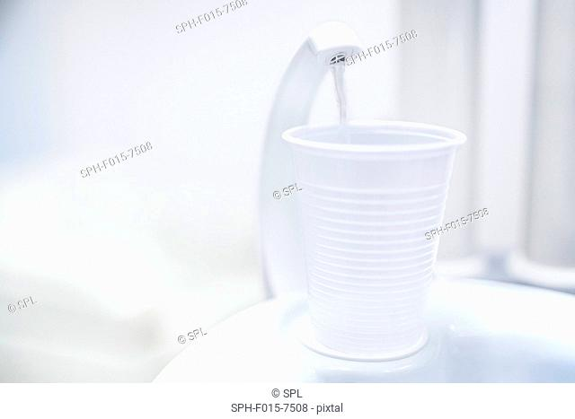 Water dispenser with disposable cup in dentist clinic