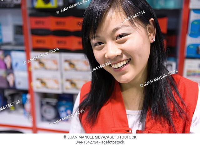 Smiley and friendly chinese saleswoman in a store at Silk Market, Beijing, China
