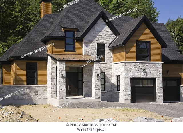 Residential home with unfinished frontyard and driveway, Quebec, Canada