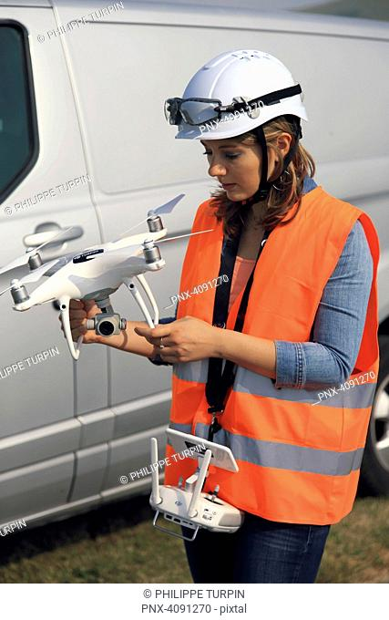 Young woman using a drone
