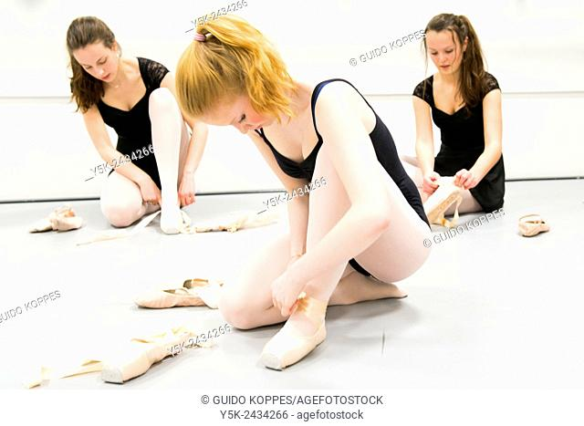 Den Bosch, 's-Hertogenbosch, Netherlands. Three teenage schoolgirls practising classical ballet at a local balletstudio