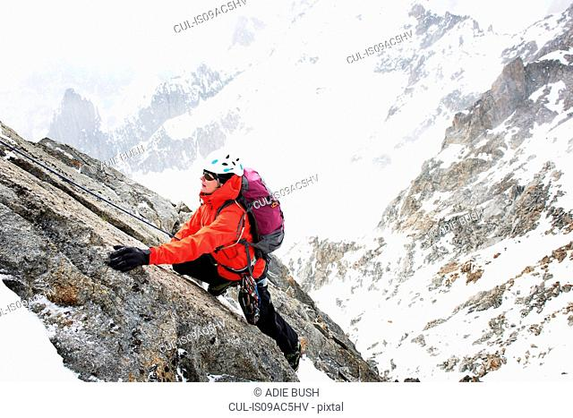 Mid adult woman mountain climbing, Chamonix, France