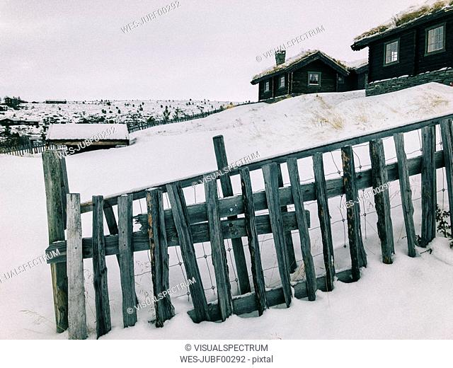 Norway, Rondane, Traditional Cabins in Norwegian Mountain Resort on Overcast Winter Day