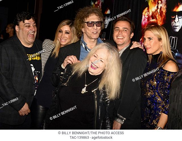 Mick Rock, Penelope Spheeris and Barnaby Clay arrive for the Premiere Of 'SHOT! The Psycho-Spiritual Mantra of Rock' held at Pacific Theatres in Los Angeles
