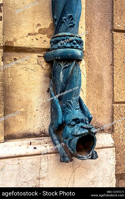 Old artistically designed iron drain pipe in Alignan du Vent. Around the village